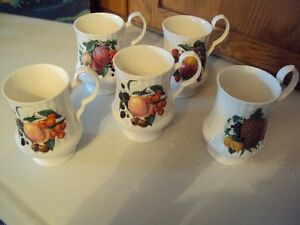 set of 5 antique china mugs from grandmother's china cabinet