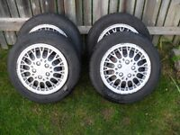 4 winter tires UNIROYAL TIGER PAW, 185/60-R14 on rims, with caps