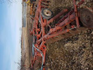 28' tandam disc  and swather 5000 diesel..
