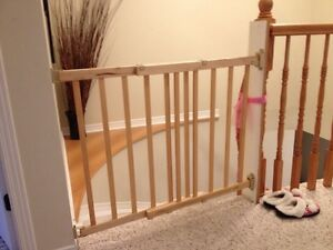 Evenflo top of stairs plus gate wood