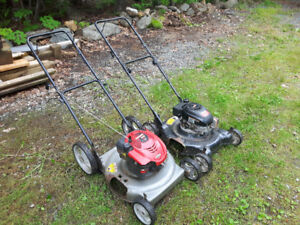 2 working  push lawn mowers, your choice $60 each