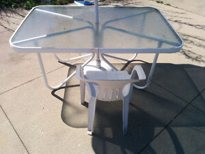 Firm condition garden table with umbrella, new price