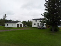 HOME WITH TRIPLE CAR GARAGE