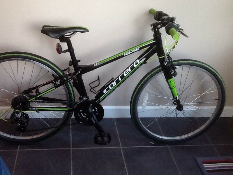"""Carrera Abyss 24"""" bike in black with green/yellow decor."""
