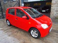 Daihatsu Charade 1.0 EL (red) 2004