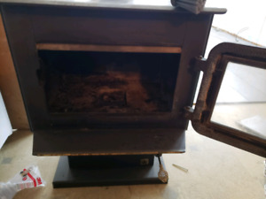 Wood burning stove with pad