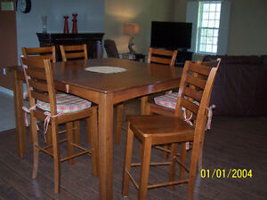 Orillia area diningroom table and 8 chairs