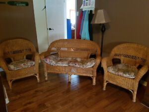 Love seat and 2 chairs with cushions.