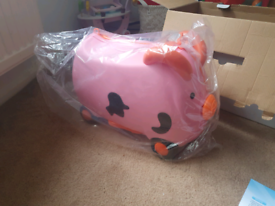 Brand new kids ride on pig suitcase