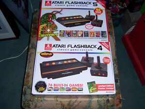 FOR SALE 3 ATARI,S  4X5 NEW IN THE BOX,ALL BUILT IN GAMES