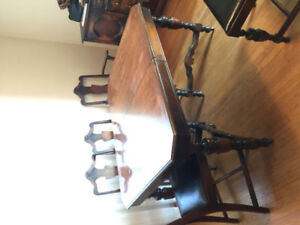 Antique dining room table set with chairs, buffet and cabinet.