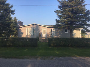 Beautiful family home with detached garage for sale