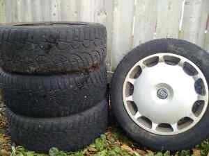 205/55/16 volvo s60 winter tires on rims with hubcaps. London Ontario image 1