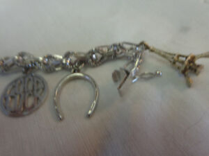 SILVER BRACELET WITH SEVEN CHARMS