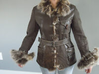 Woman leather jacket with fur