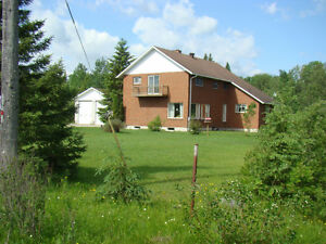 Home/Business property for sale on 5 acre lot.