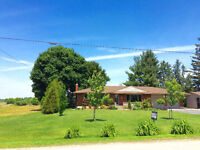 Private 1/2 Acre Lot with a Country Ranch