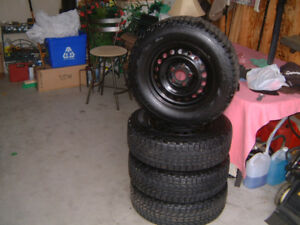 LIKE NEW -  snow tires - 205/70/R15 - Firestone Winter Force