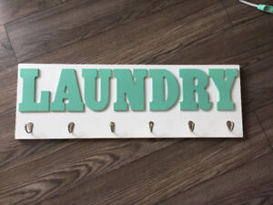 """Laundry"" sign with hooks"