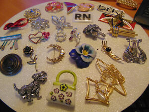 Tons of various brooches