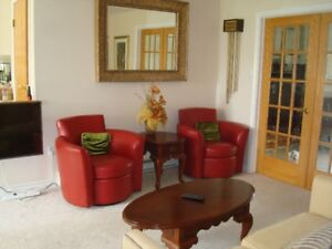 2 Identical Red Leather Swivel Chairs
