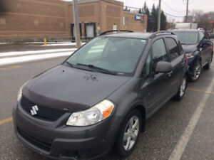 2011 SUZUKI SX4 JX AWD Bas Millage Excellente condition