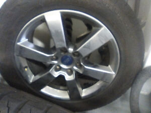 275/55/20 like new 10 k on them ford rims included