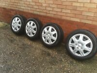 4 x 16 inch Steel Wheels with very good tyres and a set of trims