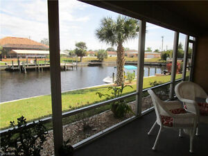 Bright & airy 1st floor end unit on gulf access canal