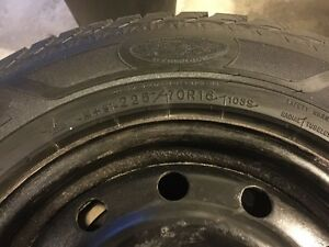Set of four GOOD YEAR  winter tires  with rims
