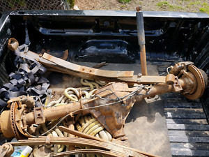 Axle and leaf springs