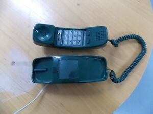 Old style phone with buttons in handset