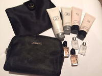 Two Armani toiletry bags with cream and perfume