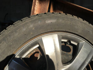 BLIZZAK LM-25 SNOW TIRES  WITH RIMS- USED ONE WINTER