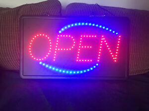 Flashing OPEN sign