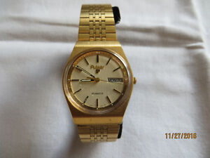 PULSAR MEN'S GOLD/STAINLESS STEEL WATCH w ORIGINAL CASE London Ontario image 1