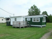 Mobile home  price was 18,000  drop to 12,000