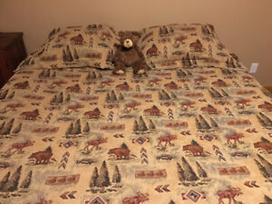 Rustic king size comforter with matching shams and bed skirt