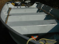 14 ft Starcraft boat, 15 hp Evinrude and trailer