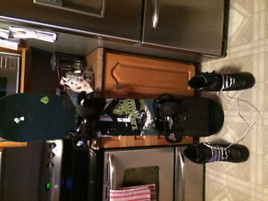 Snowboard, boots, bindings and travel bag