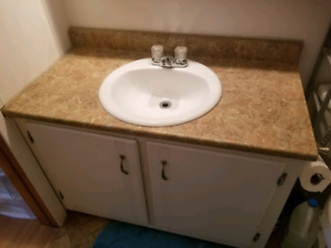 Bathroom cabinet, counter, sink and taps