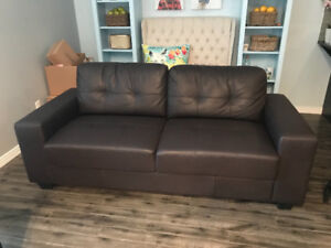 Brown pleather couch and matching oversized chair
