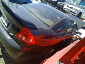 Black sedan Holden vy commodore wrecking