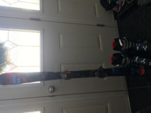 Boys Downhill skis, boots and bindings.