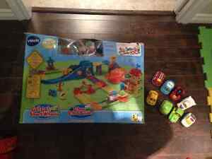 Go go smart wheels train station playset and 8 addition vehicles St. John's Newfoundland image 1
