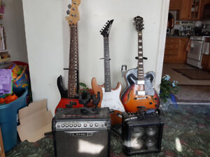 3 electric guitars with stands and two steros