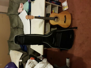 Kids acoustic guitar and case with music books