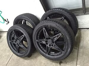 "17"" aftermarket rims with all weather performance tires"