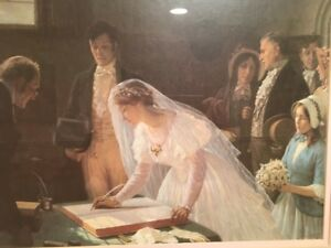 Beautiful wedding picture.  Bride & groom sign the license.