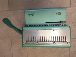 Used General Binding Machine in good condition.